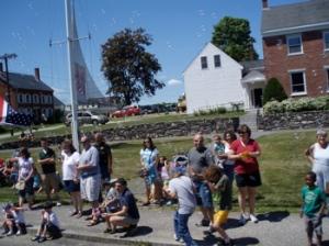 Spectators in front of the Penobscot Marine Museum