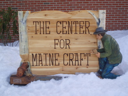 Tom Cote's Hand Carved Sign at the Entrance