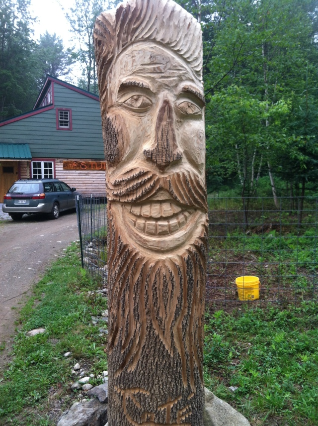 Artist in Residnece Tom Cote carved a totem for the entrance of the art studio...looks like a happy French Canadian don't you think?