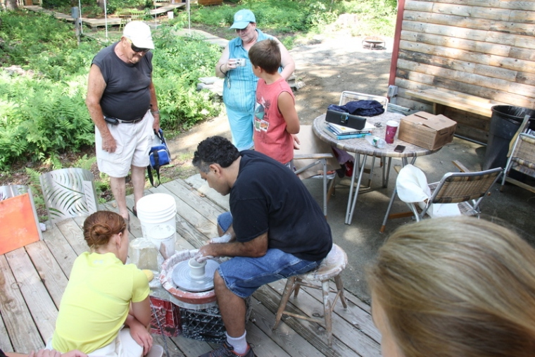 Randy Cohen stopped by to share his air dried pottery with happy guests