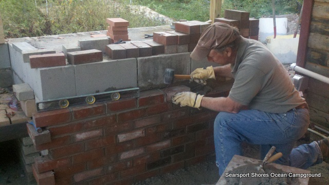 Steven started the pizza oven at the art studio...he's using clay from the property.